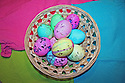 Easter eggs colorful with pastel colors and sparkle foil in basket