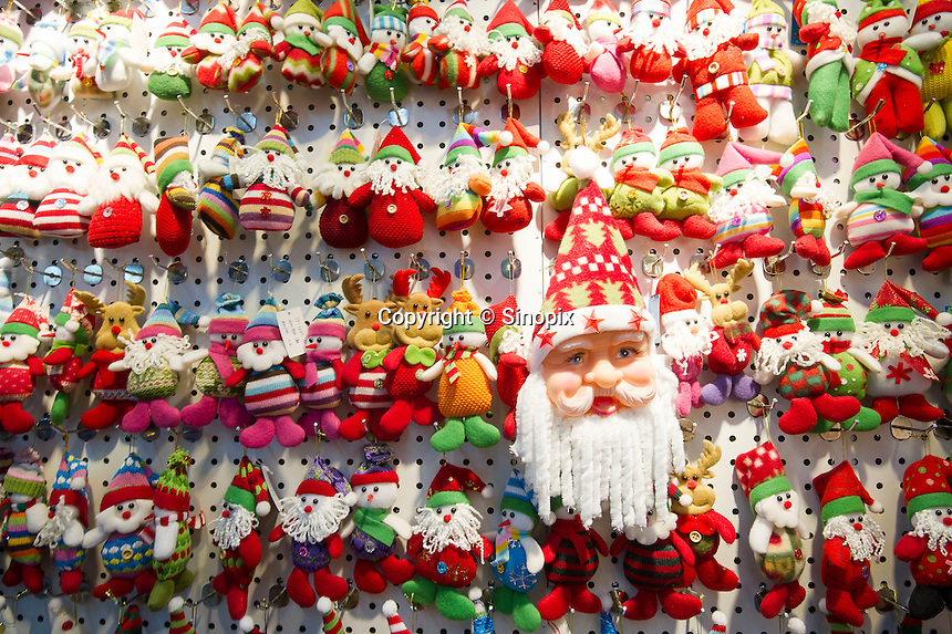 November 28, 2015, Yiwu China - Christmas decorations on display inside the Festival Arts section of the Yiwu International Trade Market. Yiwu International Trade Market is the world's largest whole sale market for small commodities. Christmas decorations are available for bulk purchase all the year round. Items such as these are often made in villages in Jiangxi Province, a poor province in central China, to keep production costs to a minimum.Photo by Dave Tacon / Sinopix