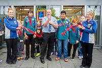 Thursday  28 July 2014<br /> Pictured: Store Manager Paul Bibby addresses the crowd and cuts the ribbon to open the store with Merthyr 2nd Scouts  and Store Staff <br /> Re: ALDI Merthyr Tydfill Grand Re-opening