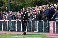 A large crowd of travelling supporters is seen behind AFC Hornchurch manager Jim McFarlane - AFC Hornchurch vs Billericay Town - Ryman League Premier Division Football at The Stadium, Upminster Bridge, Essex - 09/04/12 - MANDATORY CREDIT: Gavin Ellis/TGSPHOTO - Self billing applies where appropriate - 0845 094 6026 - contact@tgsphoto.co.uk - NO UNPAID USE