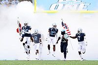CHAPEL HILL, NC - OCTOBER 10: Tony Grimes #20, Giovanni Biggers #27, and Eugene Asante #7 of North Carolina lead their team onto the field before a game between Virginia Tech and North Carolina at Kenan Memorial Stadium on October 10, 2020 in Chapel Hill, North Carolina.