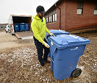 Kendall Walker, a worker with the Boston Mountain Solid Waste District, loads carts containing paper Thursday, Jan. 7, 2021, while picking up recyclables at Greenland Public Schools. The district handles recycling for several school districts in the county. Visit nwaonline.com/210108Daily/ for today's photo gallery. <br /> (NWA Democrat-Gazette/Andy Shupe)
