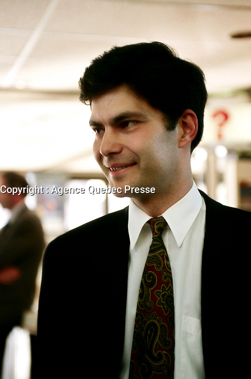 """Montreal (Qc) CANADA - May 6, 1999<br /> -File Photo -<br /> <br /> Mario Dumont, Leader of the Quebec Democratic Action (Action Democratique du Quebec - ADQ arrive at the presentation of the Bedard Report.May 6, 1999<br /> <br /> <br /> Mario Dumont (born May 19, 1970 in Saint-Georges-de-Cacouna, Quebec) is a politician in the province of Quebec, Canada. He is a Member of the National Assembly of Quebec (MNA), and the leader of the Action démocratique du Québec (ADQ) party. Based on the results of the 2007 Quebec election, Dumont is now the Leader of the Opposition in the National Assembly.<br /> <br /> Dumont was a former President of the Parti libéral du Québec's Youth Commission, but had a falling out with the party following the rejection of the Allaire Report proposing maximalist powers for Quebec after the collapse of the Meech Lake Accord.<br /> <br /> The first Liberal sovereignists Dumont called himself and Michel Bissonnet, who preceded Dumont as leader of the Liberal youth wing. This was the group that led the Liberal sovereignist faction while Liberal premier Robert Bourassa remained unopposed.[2]<br /> <br /> Dumont organized the """"Liberals for the No side,"""" in the 1992 referendum on the Charlottetown Accord.<br /> <br /> He and Liberal party insider Jean Allaire played a central role in the creation and development of the ADQ in 1994. He succeeded Allaire as leader after the latter resigned for health reasons.<br /> <br /> Dumont was elected as an ADQ member of the National Assembly for Rivière du Loup in the 1994, 1998, 2003, and 2007 elections. Dumont holds a Bachelor in Economics from Concordia University (1993) and completed some graduate work at the Université de Montréal."""