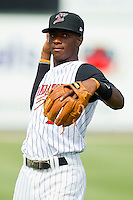 Tim Anderson (2) of the Kannapolis Intimidators warms up in the outfield prior to the game against the Greenville Drive at CMC-Northeast Stadium on June 30, 2013 in Kannapolis, North Carolina.  The Drive defeated the Intimidators 3-0.   (Brian Westerholt/Four Seam Images)
