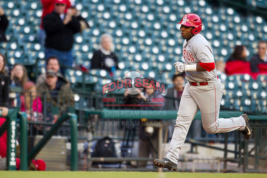 Houston Cougars third baseman Jonathan Davis #40 rounds third base after hitting a grand slam home run against the Baylor Bears in the NCAA baseball game on March 2, 2013 at Minute Maid Park in Houston, Texas. Houston defeated Baylor 15-4. (Andrew Woolley/Four Seam Images).
