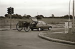 Car with cart in Shannon - July 1987. Photograph by Liam McGrath