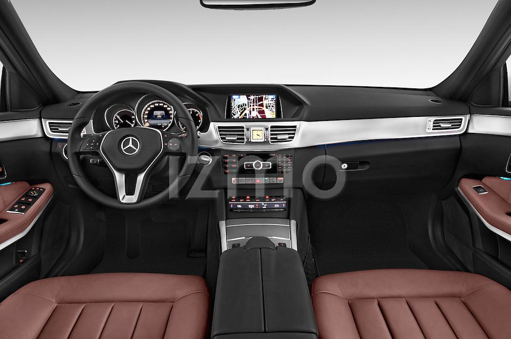 Stock photo of straight dashboard view of a 2015 Mercedes Benz Classe E E220 4 Door Sedan 2WD Dashboard