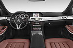 Stock photo of straight dashboard view of a 2015 Mercedes Benz Classe E E220 4 Door Sedan 2WD Dashboard