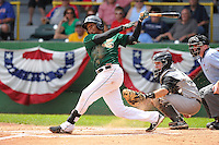 Martin Peguero #7 of the Clinton LumberKings swings against the Kane County Cougars at Ashford University Field on July 6, 2014 in Clinton, Iowa. The LumberKings won 1-0.   (Dennis Hubbard/Four Seam Images)