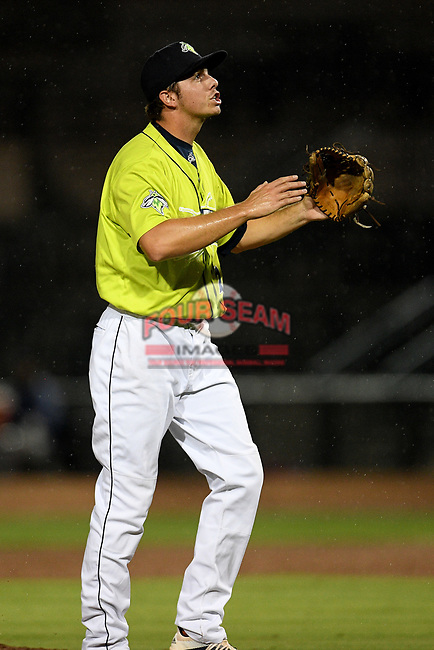 Closer Allan Winans (28) of the Columbia Fireflies shouts and raises his hands during a slight rainfall after throwing a game-ending strikeout that sealed a save in a 3-2 win over the Hickory Crawdads on Tuesday, August 27, 2019, at Segra Park in Columbia, South Carolina. (Tom Priddy/Four Seam Images)