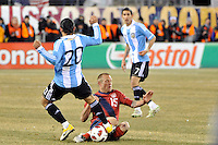 Jay DeMerit (15) of the United States goes for a tackle on Ever Banega (20) of Argentina. The United States (USA) and Argentina (ARG) played to a 1-1 tie during an international friendly at the New Meadowlands Stadium in East Rutherford, NJ, on March 26, 2011.