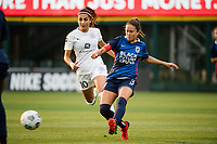TACOMA, WA - JULY 31: Lauren Barnes #3 of the OL Reign passes the ball during a game between Racing Louisville FC and OL Reign at Cheney Stadium on July 31, 2021 in Tacoma, Washington.