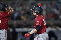 Mason Martin (23) of the Altoona Curve is greeted at home plate by teammate Canaan Smith-Njigba (24) after hitting a home run against the Somerset Patriots at TD Bank Ballpark on July 24, 2021, in Somerset NJ. (Brian Westerholt/Four Seam Images)