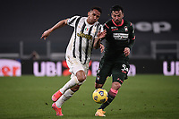 Danilo Luiz Da Silva of Juventus FC and Samuel Di Carmine of FC Crotone compete for the ball during the Serie A football match between Juventus FC and FC Crotone at Allianz stadium in Torino (Italy), February 22th, 2021. Photo Federico Tardito / Insidefoto