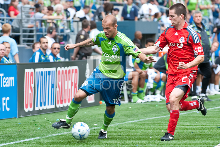 Fredy Ljungberg (L) of the Seattle Sounders works the ball against Sam Cronin (2) of Toronto FC in the match at the XBox Pitch at Quest Field on August 29, 2009. The Sounders and Toronto played to a 0-0 draw.