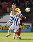 Callum Booth pulls down Greig Kiltie for a penalty kick to Kilmarnock