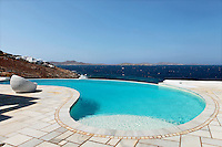 breathtaking sea view from the poolside..The villa is located in the Aleomandra area of Mykonos island in Greece, on a cliff a few meters from the sea, facing the historical island of Delos and the colorful sunset as well as only 10 minutes away from cosmopolitan town of Mykonos. It is a two floor villa with two guesthouses totaling 520 square meters with 7 bedrooms and 7 bathrooms. Simple but yet elegant, traditional but yet modern minimal style and design.
