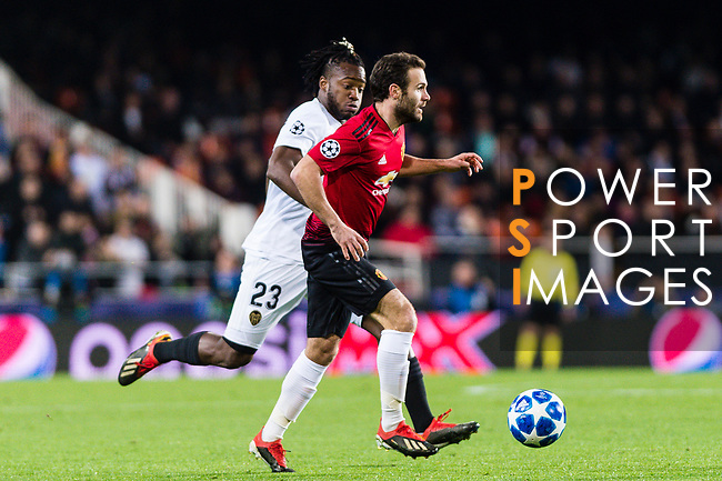 Juan Mata of Manchester United (R) in action against Michy Batshuayi of Valencia CF (L) during the UEFA Champions League 2018-19 match between Valencia CF and Manchester United at Estadio de Mestalla on December 12 2018 in Valencia, Spain. Photo by Maria Jose Segovia Carmona / Power Sport Images