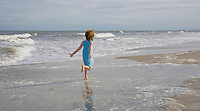 Child running on the beach, New Jersey