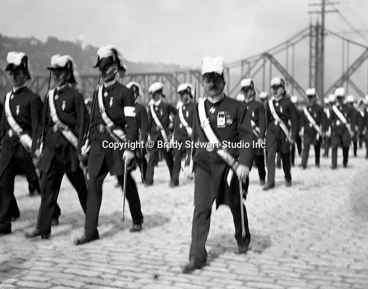 Pittsburgh PA:  Pittsburgh-area Manson marching in the annual St Patrick's Day Parade.  View of Homer Stewart and fellow Masons marching down Water Street with the new Wabash Bridge in the background.