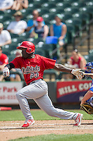 Memphis Redbirds second baseman Jermaine Curtis #23 follows through on his swing during the Pacific Coast League baseball game against the Round Rock Express on April 27, 2014 at the Dell Diamond in Round Rock, Texas. The Express defeated the Redbirds 6-2. (Andrew Woolley/Four Seam Images)