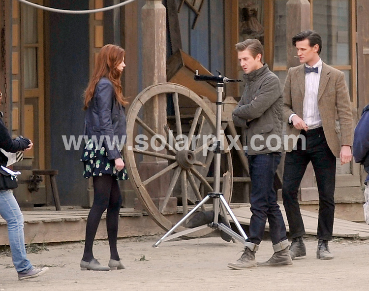 """**ALL ROUND PICTURES FROM SOLARPIX.COM**                                             **WORLDWIDE SYNDICATION**                                                                                  Caption: Matt Smith and Karen Gillan who plays his companion Amy Pond of Doctor Who called """"Gun Slingers"""".Matt & Karen were joined today by a friend who looks ver similar to Matt.Could be a brother or a new love interest for Karen?                                                        ...This pic:  Matt Smith and Karen Gillan                                                                                            JOB REF: 14549       RAP       DATE: 09.03.2012                                                           **MUST CREDIT SOLARPIX.COM OR DOUBLE FEE WILL BE CHARGED**                                                                      **MUST AGREE FEE BEFORE ONLINE USAGE**                               **CALL US ON: +34 952 811 768 or LOW RATE FROM UK 0844 617 7637**"""