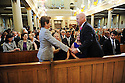 US Rep Nancy Pelosi greets Mayor Mitch Landrieu at former US Rep. Lindy Boggs'  funeral at St. Louis Cathedral, New Orleans, Aug. 1, 2013.
