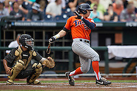 Cal State Fullerton Titans outfielder Dalton Blaser (22) follows through on his swing during the NCAA College baseball World Series against the Vanderbilt Commodores on June 14, 2015 at TD Ameritrade Park in Omaha, Nebraska. The Titans were leading 3-0 in the bottom of the sixth inning when the game was suspended by rain. (Andrew Woolley/Four Seam Images)
