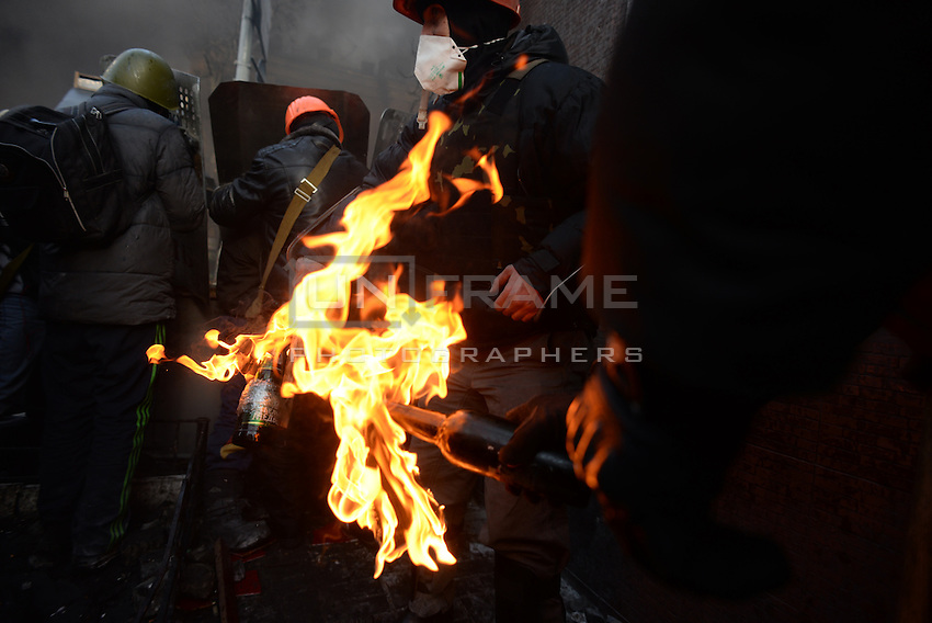 Protesters ignite petrol bombs to be next launched towards the riot police. Kiev, Ukraine