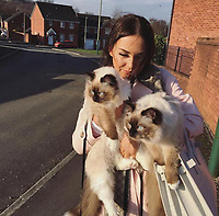 COPY BY TOM BEDFORD<br /> Pictured: Emily Lock with her Siamese cats<br /> Re: Emily Lock, who studied law and criminology at university was jailed for 15 months along with her drug dealing boyfriend who was given a seven-year prison sentence<br /> 22 year old Lock, a former pupil at Fleur-de-Lys' Ysgol Gyfun Cwm Rhymni, had hoped one day that she would become a probation officer but a modern fascination with a Kim Kardashian type of lifestyle was hinted at as a motivation for her fall.<br /> But her dreams are in tatters after she was put behind bars at Merthyr Tydfil Crown Court after admitting acquiring criminal property.<br /> Lock, the court heard had posted pictures of herself living the highlife on Instagram and that over the space of a year in 2016, she had been on holiday to Amsterdam twice, Paris, Alicante, Miami and Dubai.