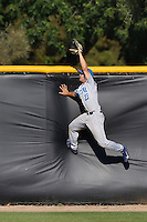 Joey Epperson #23 of the UC Santa Barbara Gauchos can't catch a home run during a game against the Cal State Northridge Matadors at Matador Field on May 10, 2013 in Northridge, California. UC Santa Barbara defeated Cal State Northridge, 6-1. (Larry Goren/Four Seam Images)