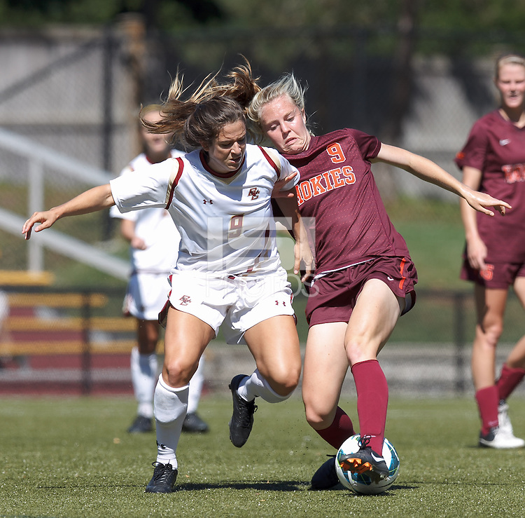 Virginia Tech midfielder Kelsey Loupee (9) successfully defends attacking Boston College forward Stephanie McCaffrey (9).Virginia Tech (maroon) defeated Boston College (white), 1-0, at Newton Soccer Field, on September 22, 2013.