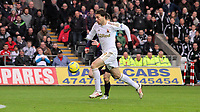 Sunday 06 January 2013<br /> Pictured: MIchu of Swansea is scoring the opening goal. <br /> Re: FA Cup third round, Swansea City FC v Arsenal at the Liberty Stadium, south Wales.