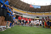 Major League Soccer referees enter the field at RFK stadium. DC United defeated the New York Red Bulls, 4-2, at RFK Stadium in Washington DC, Sunday, June 10 , 2007.