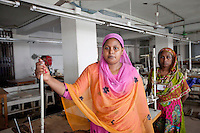 Two garments worker poses for a portrait inside the factory.  The garments workers of Tuba group gathered in a protest demanding their outstanding wages and Eid bonus.  Dhaka, Bangladesh