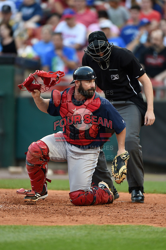 Pawtucket Red Sox catcher Dan Butler (12) looks for a pitch in the dirt in front of umpire Nick Letz during a game against the Buffalo Bisons on August 26, 2014 at Coca-Cola Field in Buffalo, New  York.  Pawtucket defeated Buffalo 9-3.  (Mike Janes/Four Seam Images)