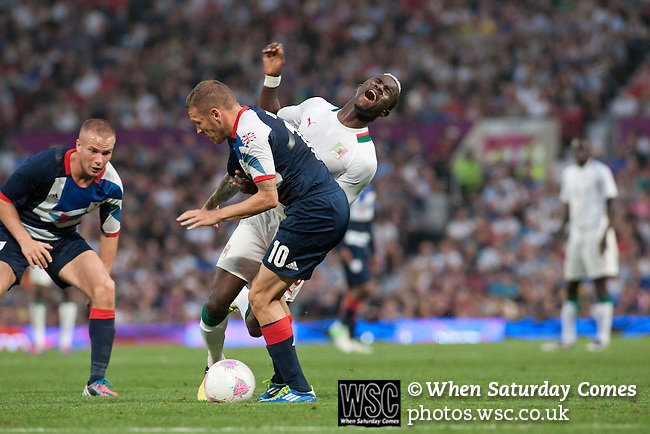 Uruguay 2 United Arab Emirates 1, Great Britain 1 Senegal 1, 26/07/2012. Old Trafford, Olympic Games. Great Britain's Craig Bellamy (blue shirt) tackles Pape Souare of Senegal at Manchester United's Old Trafford stadium during their team's opening Men's Olympic Football tournament match at the venue. The double header of matches resulted in Uruguay defeating the United Arab Emirates by 2-1 while Great Britain and Senegal drew 1-1. Over 72,000 spectators attended the two Group A matches. Photo by Colin McPherson.