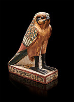 Ancient Egyptian wooden falcon bird, Late Period (722-322 BC), Egyptian Museum, Turin. Cat 986. black background <br /> <br /> Wooden tomb models were an Egyptian funerary custom from the Middle Kingdom in which wooden figurines and sets were constructed to be placed in the tombs of Egyptian royalty. These wooden models represented the work of servants, farmers, other skilled craftsman, armies, and religious rituals