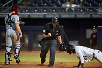 Umpire Paul Clemons calls C.J. Chatham (24) out at home plate after being tagged by Surprise Saguaros catcher Jakson Reetz (4) during an Arizona Fall League game against the Peoria Javelinas on September 22, 2019 at Peoria Sports Complex in Peoria, Arizona. Surprise defeated Peoria 2-1. (Zachary Lucy/Four Seam Images)
