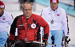Sochi, RUSSIA - Mar 10 2014 -  Dennis Thiessen during Canada vs Norway in Wheelchair Curling round robin play at the 2014 Paralympic Winter Games in Sochi, Russia.  (Photo: Matthew Murnaghan/Canadian Paralympic Committee)