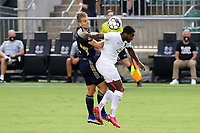 CARY, NC - AUGUST 01: Brian Wright #7 and Sam Brotherton #5 challenge for a header during a game between Birmingham Legion FC and North Carolina FC at Sahlen's Stadium at WakeMed Soccer Park on August 01, 2020 in Cary, North Carolina.