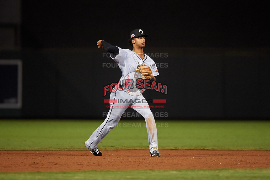 Glendale Desert Dogs shortstop Jose Garcia (6), of the Cincinnati Reds organization, throws to first base during an Arizona Fall League game against the Scottsdale Scorpions on September 20, 2019 at Salt River Fields at Talking Stick in Scottsdale, Arizona. Scottsdale defeated Glendale 3-2. (Zachary Lucy/Four Seam Images)