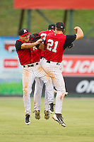 (L-R) Bill Rice (20), Adam Heisler (35) and Mark Haddow (21) celebrate their win over the Rome Braves at CMC-Northeast Stadium on August 5, 2012 in Kannapolis, North Carolina.  The Intimidators defeated the Braves 9-1.  (Brian Westerholt/Four Seam Images)