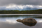 Storm clouds over Lonesome Lake in Franconia Notch State Park of the White Mountains, New Hampshire USA. The Appalachian Trail passes by this lake.