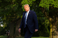 United States President Donald J. Trump walks on the South Lawn of the White House after arriving on Marine One in Washington, D.C., U.S., on Sunday, June 14, 2020.  Trump tweeted that he will not watch the NFL or the U.S. Soccer Federation if either organization allows players to kneel during the playing of the American National Anthem.  <br /> Credit: Stefani Reynolds / Pool via CNP/AdMedia