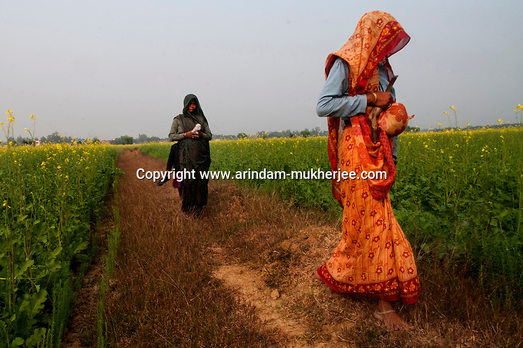 Covering their faces farm hands walk through the mustard field in Uttar Pradesh, India. These women come from the backward dalit communities and suffer various types of gender crimes including molestation and rape. Crimes against women have been going on since centuries. In India, women have been categorically marginalized with various types of repressions enforced upon them. Be it home or outside, an Indian woman is potentially at the risk of being discriminated against, molested, raped and even killed. Until recently, turning a blind eye to such crimes has been the norm in largely gender-biased Indian society. But after the brutal gang rape and subsequent death of the Delhi Physiotherapy student, the so-far-silent middle class has turned vocal.