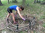volunteer/intern building one of the nests