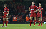 Dejected Welsh players Leigh Halfpenny, Mike Phillips and Rhys Webb at the final whistle.<br /> Dove men Series 2014<br /> Wales v New Zealand<br /> 22.11.14<br /> ©Steve Pope -SPORTINGWALES