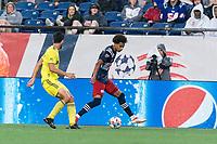 FOXBOROUGH, MA - AUGUST 4: Tajon Buchanan #17 of New England Revolution dribbles down the wing as Eric Miller #15 of Nashville SC closes during a game between Nashville SC and New England Revolution at Gillette Stadium on August 4, 2021 in Foxborough, Massachusetts.