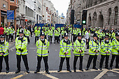 Police blockade Fleet Street to prevent access to the St.Paul's Cathedral Occupy camp during a National Campaign against Fees and Cuts march through the City of London.